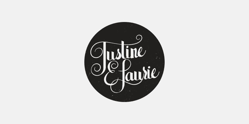 Justine E. Laurie logo