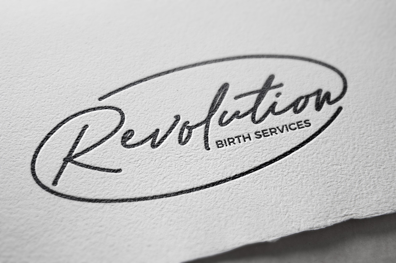 Revolution Birth Services logo mockup relief printed on textured paper by Sarah DaSilva